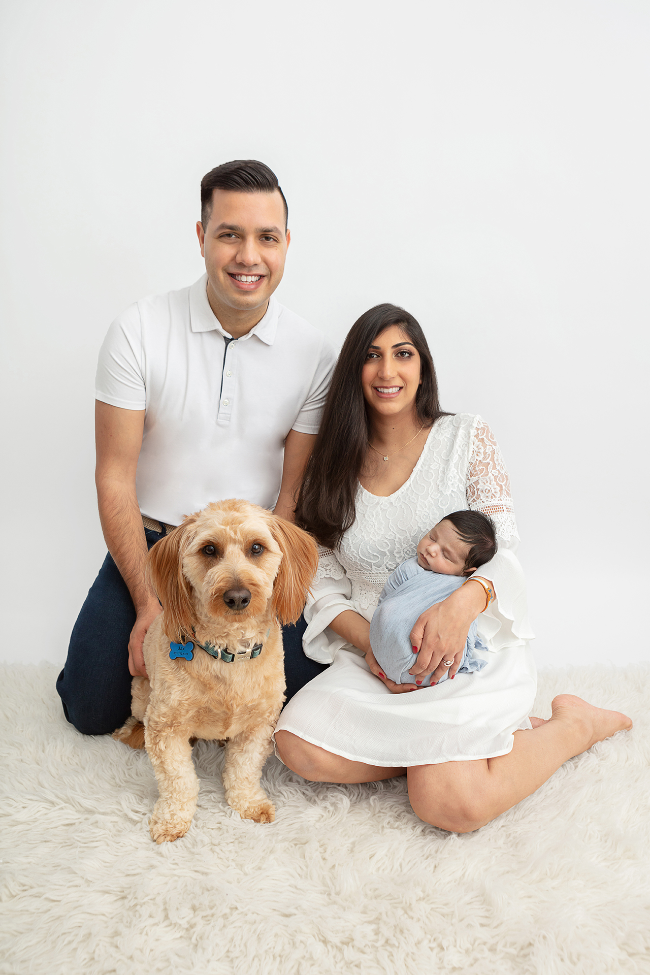 family newborn photography with miniature golden doodle, family medicine doctor dad, dentist mom, newborn baby boy